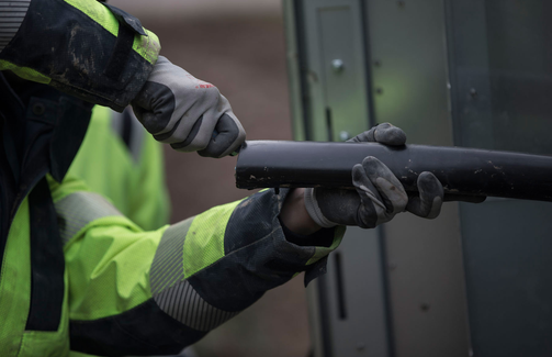Cable worker removing sheath from medium voltage cable